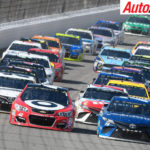 Kyle Larson and Martin Truex Jr leading on the restart at Michigan - Photo: LAT